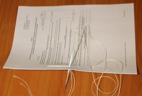 Как сшивать документы нитками для налоговой: Этап №4