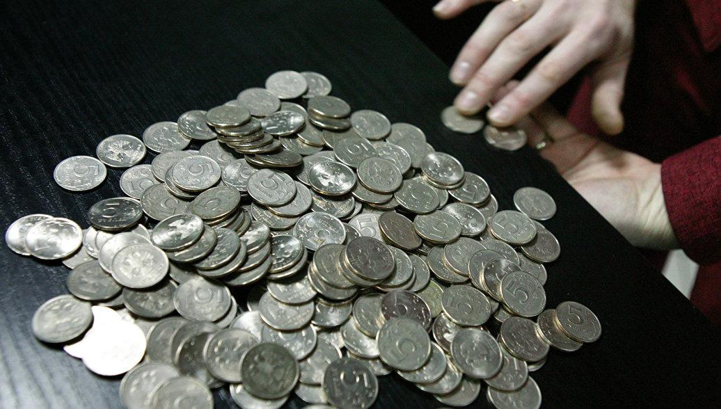 Общий вес монет в ящиках был 22 кг